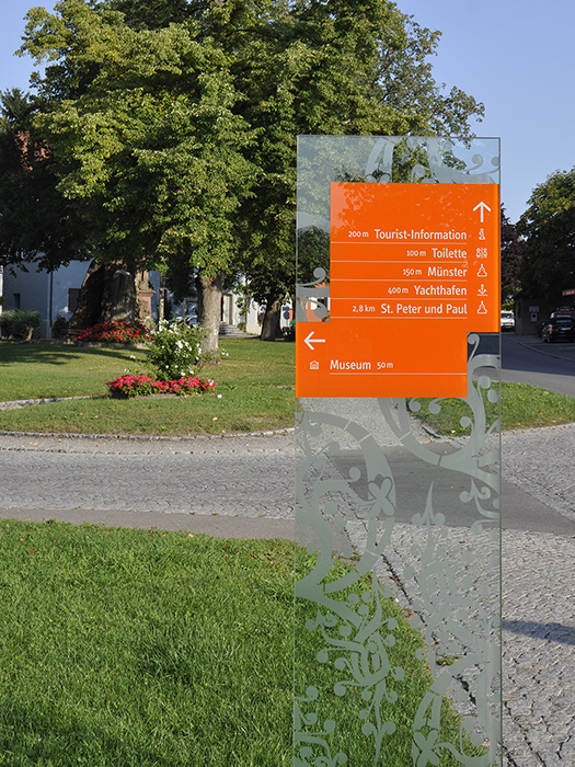 directional sign on glass near the reichenau museum - brian switzer, envision+